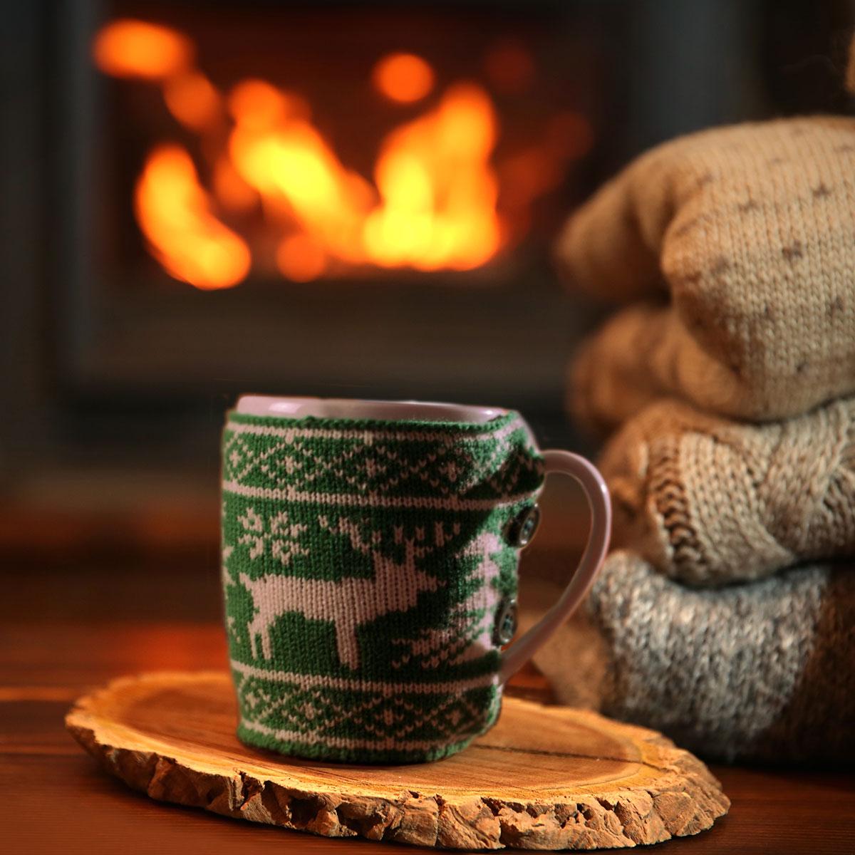 Tasse mit Weihnachtspullover